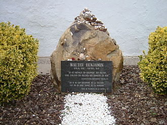 "Walter Benjamin - Walter Benjamin's grave in Portbou. The epitaph in German, repeated in Catalan, quotes from Section 7 of Theses on the Philosophy of History: ""There is no document of culture which is not at the same time a document of barbarism"""