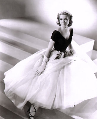 Grace Kelly - Kelly in a promotional photograph for Rear Window (1954)