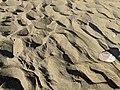 Green sand at Papakolea green sand beach in Hawaii.jpg