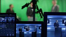 Applicazione di una chiave cromatica verde in uno studio televisivo