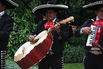 Guitarrón mexicano - A guitarrón player in a Mariachi uniform.