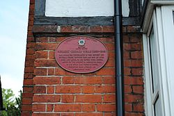 Photo of H. G. Wells red plaque