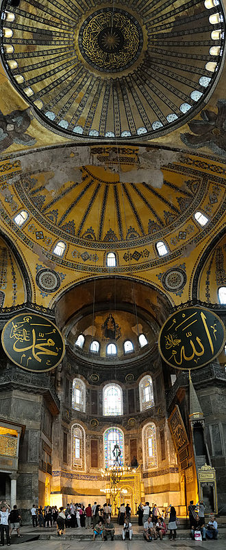 Interior view of the Hagia Sophia, showing Christian and Islamic elements on the main dome and pendentives (annotations). HagiaSophia DomeVerticalPano (pixinn.net).jpg