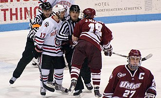 Penalty (ice hockey) - Verbal or physical altercations between opposing players or on-ice officials, may lead to a misconduct penalty, such as this one between a UMass player (red) and a Northeastern University player (white). The player in white was given the misconduct.