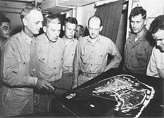Franklin A. Hart - Col Franklin A. Hart (left), commander of the 24th Marines, briefs his staff on the operation plan for the invasion of Roi-Namur.