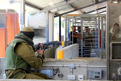 An Israeli military checkpoint in the occupied West Bank. Hawara checkpoint 2.jpg