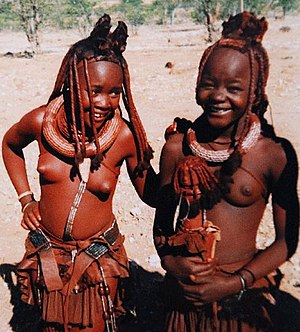 Himba people - Young Himba girls. The Erembe headdress indicates both are married.