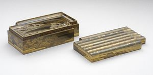 Kōbako - Incense box in the form of a raft with flowers, mid-19th century