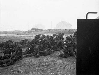 Sword Beach - British infantry waiting to move off 'Queen White' Beach, SWORD Area, while under heavy enemy fire, on the morning of 6 June