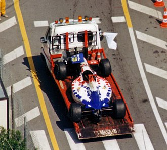 Taki Inoue - Inoue's damaged car is towed back to the pits after his bizarre practice accident at the 1995 Monaco Grand Prix.