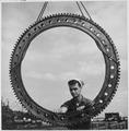 "Installing a bearing ring on a 5"" inch gun aboard a submarine at an advanced base. - NARA - 520837.tif"
