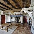 Interieur overzicht woonkeuken met schouw en balkenplafond - Berlicum - 20330753 - RCE.jpg
