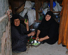 Iraqi women in their kitchen preparing a meal for a luncheon.jpg