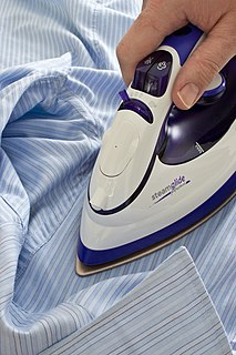 Ironing process of removing wrinkles from fabric by using an iron