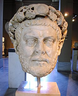 Statue of a male head wearing a diadem