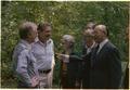 Jimmy Carter, Ezer Weizman, Mrs. Begin, Menahem Begin and members of the Israeli delegation at Camp David. - NARA - 181337.tif