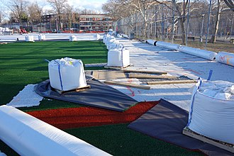 Artificial turf - Artificial turf being installed on a baseball field in Queens, New York City.