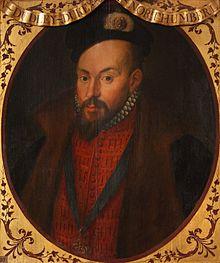Pieni muotokuva Earl of Warwickista, runsaasti pukeutuneena viistettyyn dublettiin, sukkanauharitarikunnan kanssa kaulassa.  Hän on komea mies, jolla on tummat silmät ja tumma pukin parta.