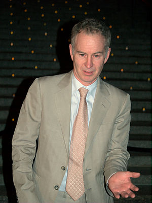 John McEnroe - McEnroe demonstrating his swing at a Vanity Fair party in New York City.