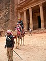 Jordan, Petra. The Treasury of the Pharaoh. People and camel.jpg