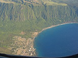 "Most of the village of Kalaupapa as seen from an airplane. This photo also includes a section of the sea cliffs that form a natural barrier between the Kalaupapa Peninsula and ""Topside"" Molokaʻi."