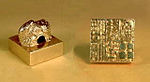 =Square gold seal with Chinese characters