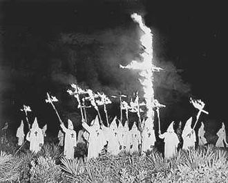 White - A cross burning by the racist Ku Klux Klan in Florida in the early 20th century.