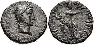 "Julio-Claudian dynasty - Coin of Kushan ruler Kujula Kadphises (Circa AD 30/50-80). Obv Laureate ""Julio-Claudian"" style head right. Rev Kujula Kadphises seated right, raising hand; tripartite symbol to left."
