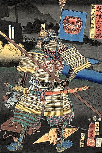Tachi - A back view of a samurai in armor carrying a tachi sword, on his back is a sashimono, holding a spear and a severed head.