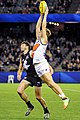Lachie Whitfield marking over Dale Thomas.jpg