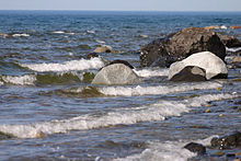 A picture of rocks on a lakeshore