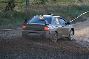 H. Paddon driving his Mitsubishi Lancer Evo gr...