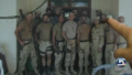 Layne Morris points at a photo a fellow GI took of his unit, in Afghanistan, in 2002 -a.png