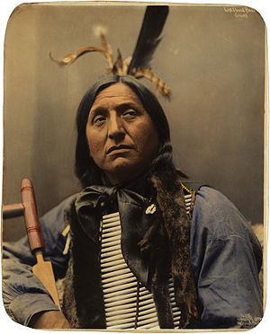 Breastplate - Left Hand Bear, an Oglala Lakota chief, wearing a hair-pipe breastplate, Omaha, 1898.