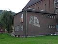 Leoben-Donawitz - Pfarrkirche hl Josef - ehemaliges Mesnerhäusl mit Sgraffito.jpg