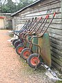 Line of wheelbarrows at Arlington Court, Devon.jpg