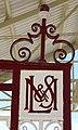 London Midland & Scottish emblem cast in to the gates of Llandudno railway station.jpg