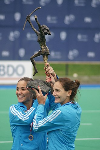 Luciana Aymar - Luciana Aymar and Soledad Garcia raise the trophy after beating the Netherlands in the 2010 Hockey World Cup at Rosario.