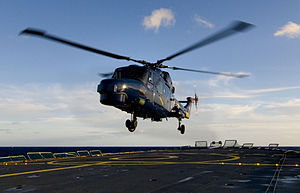 Danish Naval Air Squadron - DNAS Super Lynx Mk.90B landing on a Thetis-class vessel