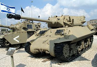 M10 tank destroyer - M10C. The muzzle brake and a small counterweight bolted to the gun barrel are visible.
