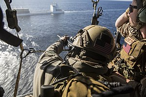 Modular Integrated Communications Helmet - US Marines with the 15th Marine Expeditionary Unit's Maritime Raid Force practice maritime interoperability training. Note the TC-2000 helmet the sniper is using.