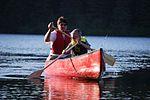 Man and boy paddle a canoe.jpg