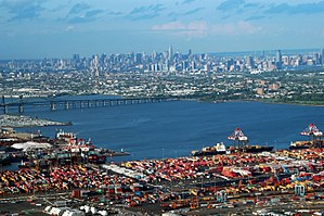 Newark Bay - Port Newark is seen in the foreground looking northeast across the bay to Jersey City and the Manhattan borough of New York City.