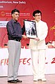 Manish Tewari presenting a memento to the Legendary Chinese Actor, Mr. Jackie Chan, at the inaugural ceremony of the Chinese Film Festival 2013, in New Delhi on June 18, 2013.jpg