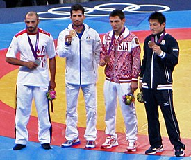 Medalists at the Men's 60 kg Greco Roman Wrestling.jpg