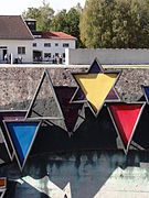 Memorial with Prisoners Triangle Badges and Star of David Badge - Dachau Concentration Camp Site - Dachau - Bavaria - Germany