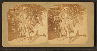 Vaquero - Image of a man and horse in Mexican-style equipment, horse in a two-rein bridle