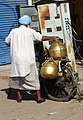 Milk vender with typical traditional brass containers , Gagar ,used in Majha Region of Punjab 01.jpg