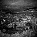 Miners operate a machine for gathering coal.jpg