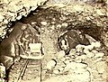 Miners working in underground gold mine by candlelight, Yukon Territory, ca 1898 (MEED 62).jpg